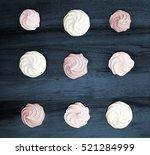 colorful meringues on dark blue ... | Shutterstock . vector #521284999