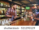 cheerful bearded young barman... | Shutterstock . vector #521293129