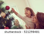 mother and daughter decorating... | Shutterstock . vector #521298481