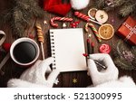santa claus with open notepad... | Shutterstock . vector #521300995
