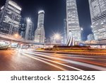 light trails on the roundabout... | Shutterstock . vector #521304265