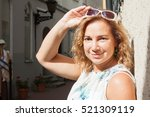 young blond woman in white... | Shutterstock . vector #521309119