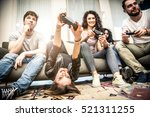 friends having fun on the couch ... | Shutterstock . vector #521311255