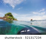 small boat and island with... | Shutterstock . vector #521317234