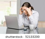 young woman sitting at desk... | Shutterstock . vector #52133200