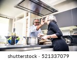 senior couple cooking and... | Shutterstock . vector #521337079