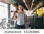 personal trainer helping woman... | Shutterstock . vector #521360881