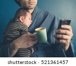 a young father in a bathrobe is ... | Shutterstock . vector #521361457