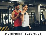 personal trainer instructing... | Shutterstock . vector #521375785
