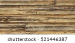 Old Hewn Natural Log Cabin Or Barn Wall Texture. Rustic Log House Vintage Wall Horizontal Background. Cracked Wooden Debarked Log Rural Wall Structure. Abstract Wooden Web Banner Backgrounds Textures