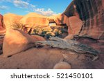 Stock photo desert sunrise with a natural arch in devils garden utah usa 521450101