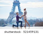 romantic engagement in paris ... | Shutterstock . vector #521459131