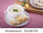 Mustard soup and tulip - stock photo