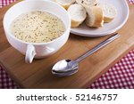 Bowl of mustard soup with bread - stock photo