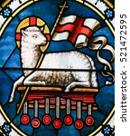 Small photo of STOCKHOLM, SWEDEN - APRIL 16, 2010: Agnus Dei. Stained Glass of a lamb holding a Christian banner, symbol for Lamb of God.