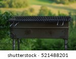 A Empty Portable Bbq Grill In...
