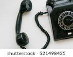 black retro phone on a white