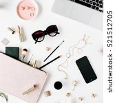 Small photo of Flat lay, top view office table desk frame. feminine desk workspace with laptop, clutch, cosmetics, phone, sunglasses, lipstick rose buds on white background.