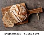 freshly baked bread on dark... | Shutterstock . vector #521515195