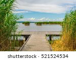 A Wooden Pier Surrounded By...