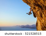 rock climber jumping on... | Shutterstock . vector #521528515