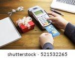 cashier hand holding a credit... | Shutterstock . vector #521532265
