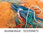 Fishing Nets Piled Together At...