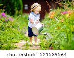 cute toddler boy in straw hat... | Shutterstock . vector #521539564