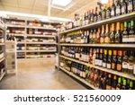 blurred image of wine shelves... | Shutterstock . vector #521560009