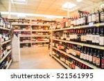 blurred image of wine shelves... | Shutterstock . vector #521561995