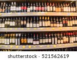 blurred image of wine shelves... | Shutterstock . vector #521562619
