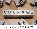 Small photo of Courage Word Written In Wooden Cube