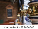 beer dispenser in a pub...   Shutterstock . vector #521606545