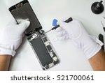 close up hands holding broken... | Shutterstock . vector #521700061