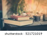 glasses with books and pen on... | Shutterstock . vector #521721019