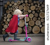 Small photo of Superhero Baby Boy Using Scooter Adorable Concept