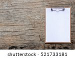 Clipboard With White Sheet On...