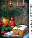 Small photo of Traditional Christmas fruit c�ake decorated with powdered sugar and xmas decorations, candle. copy space. style rustic. selective focus