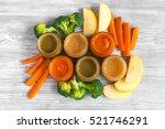 baby vegetable puree on wooden... | Shutterstock . vector #521746291