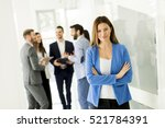 businesswoman posing while... | Shutterstock . vector #521784391