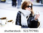 Young Woman Sitting At The...