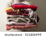 winter clothes stacked in front ... | Shutterstock . vector #521806999