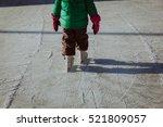 child feet learning to skate on ...   Shutterstock . vector #521809057