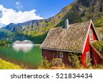 red cottage against cruise ship ... | Shutterstock . vector #521834434