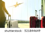 Small photo of business man and stack of traveling luggage standing in airport terminal and passenger plane flying above