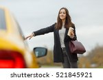 brunette on road stop taxi | Shutterstock . vector #521845921