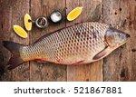 fresh raw wild carp with lemon  ... | Shutterstock . vector #521867881