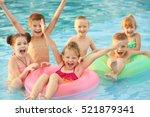 little kids in swimming pool on ... | Shutterstock . vector #521879341