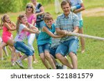 children and adults are pulling ... | Shutterstock . vector #521881579