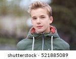 portrait of teenager outdoors... | Shutterstock . vector #521885089